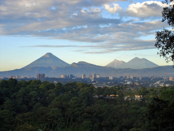 View of Guatemala City with volcanoes in the background. (Photo credit: Wikipedia)
